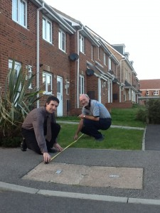 Alex is pictured with Chris measuring the distance between the service point and the houses.