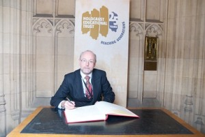 Alex stands up to prejudice by signing Holocaust Memorial Day Book of Commitment