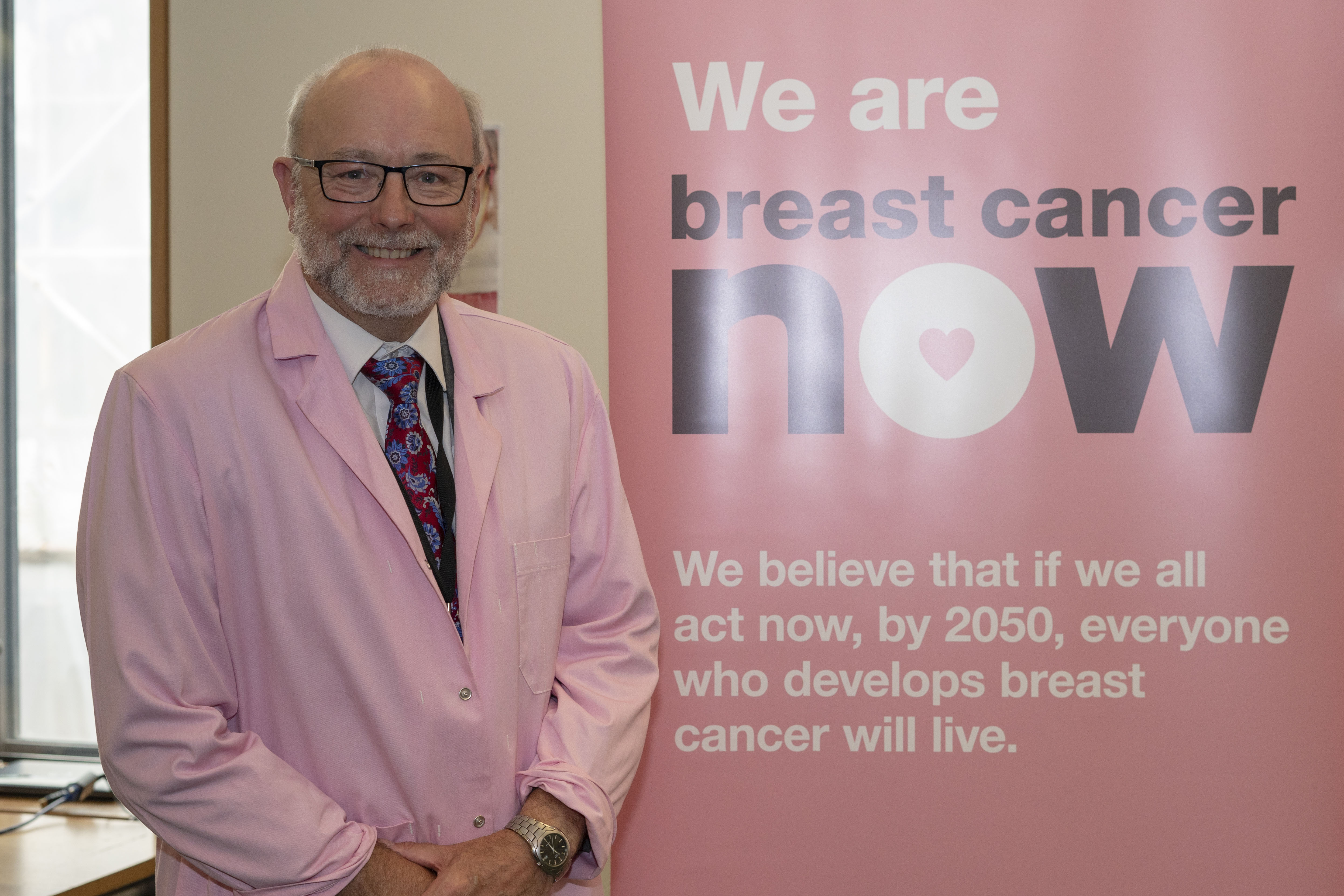Alex gets behind the microscope at Breast Cancer Now research fair in Parliament