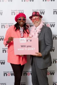 Alex poses in pink in Parliament to support Breast Cancer Now